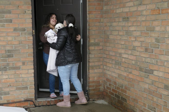 Edith Espinal hugs daughter Stephanie Gonzalez Thursday as she arrives at her apartment on the West Side for the first time in more than three years after living in sanctuary at the Columbus Mennonite Church in Clintonville.