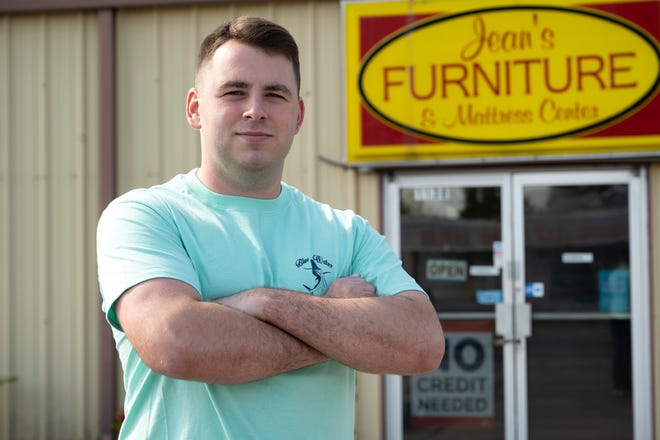 Jacob Hobby stands in front of his father's business, Jean's Furniture & Mattress Center in Eustis. Jacob is currently serving in the United States Marine Corps and is stationed in California.