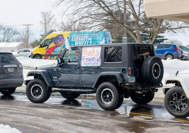 Cambridge Rotary members made signs to display on their vehicles for the car parade to thank frontline workers for their service during difficult times.