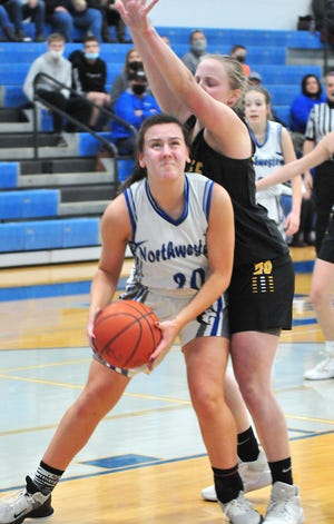 Northwestern's Allie Spencer gets position down low against Black River in sectional semifinal hoops action. The Huskies won 62-29 to advance to the sectional finals.