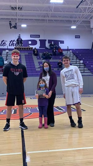 Lisa Acker and Leah Faye Acker (center) present the Rhett Acker Family Memorial Sportman's Award to Orrville's Cooper Haley (left) and Triway's Colton Snyder (right).  The award is named for 2003 Triway grad Rhett Acker, an avid supporter of Triway athletics before his death in 2016. One junior or senior basketball player from Orrville and Triway are selected for the award each year. Qualifications include: strong moral compass, competitive attitude and knowledge of the game. Winners receive a plaque and the Acker family donates $250 to the athletic booster clubs of both schools.