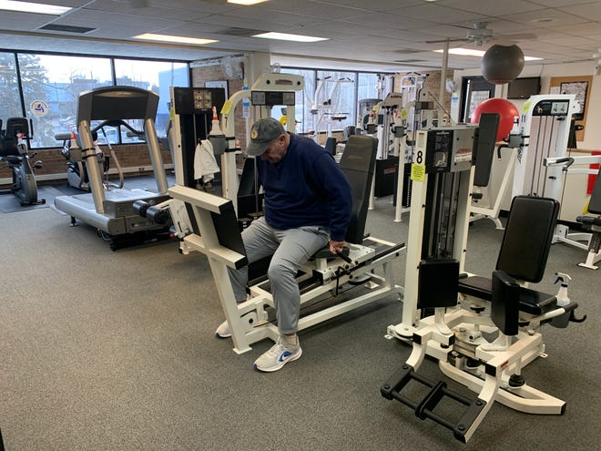 Bill Moorehead of Wooster gets ready to use the leg press in the fitness center at the Wooster Community Center on Wednesday. The fitness center reopened on Feb. 1 and limited fitness programming will resume on March 1.