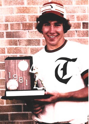 Former Tecumseh High School varsity baseball player Derek Nahabedian, who died last summer, is pictured holding a trophy during his senior year in 1981.