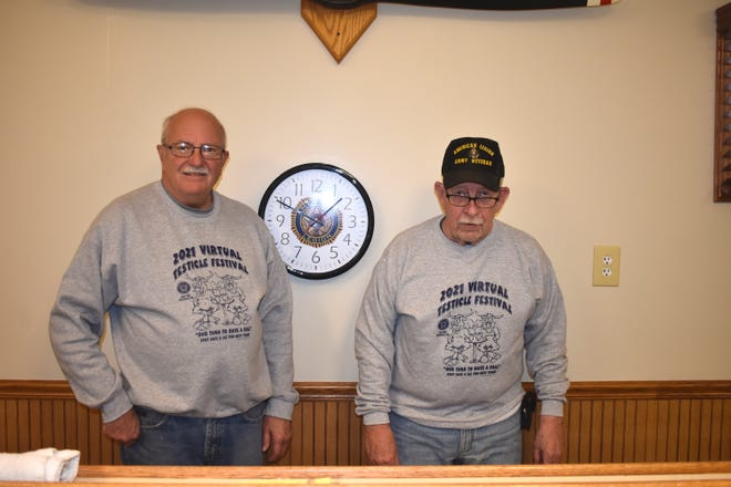 """Deerfield American Legion Post No. 392 members Nick Pulver, left, and Terry Dickerson show off the Legion's new shirt designs for the 2021 """"Virtual Testicle Festival."""" At this time, the Legion's annual and most profitable event of the year is postponed by the COVID-19 pandemic."""