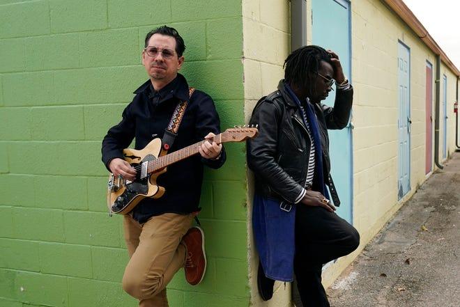 Adrian Quesada, left, and Eric Burton of Black Pumas pose for a portrait Feb. 5 in Austin.