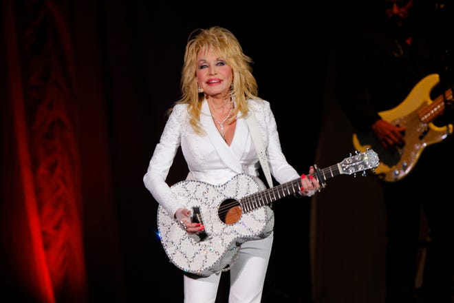 Dolly Parton performs July 31, 2015, in Nashville, Tenn. Parton is asking Tennessee lawmakers to withdraw a bill that would erect a statue of her on the Capitol grounds in Nashville.