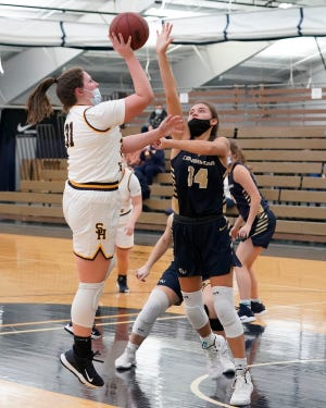 Siena Heights' Peyton Banks goes up for a shot during a game against Cornerstone earlier in the 2020-21 season.