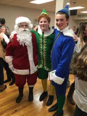 Brayden Daughtry, (dressed as Santa) is looking forward to once again participating in in-person theater camps offered by Lexington Youth Theater. Also in this photo from the 2020 LYT production of 'Elf The Musical' is Carson Shoaf (center) who played Buddy the Elf, and Bailey Daugherty, Brayden's brother, (right) who played Walter Hobbs.