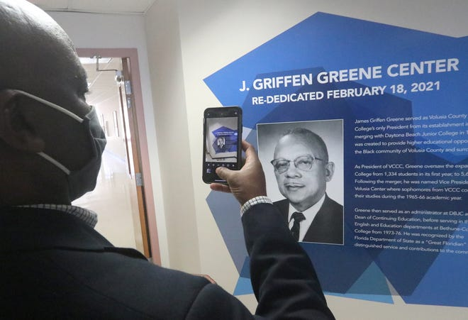Daytona Beach Mayor Derrick Henry snaps a photo of the mural inside the J. Griffen Greene Center on Thursday February 18, 2021. Greene, who served as Volusia County Community College's only president from 1957 to 1965 and was a pioneer in education for the Black community, was remembered at an event at Daytona State College last week.