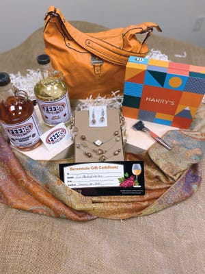 "The ""Night on the Town"" prize package, valued at $309, contains a $100 Benvenuto gift certificate, a bottle of Feebs Distilling Co. Apple Brandy Moonshine, a bottle of Feebs Blackberry Brandy Moonshine, a $50 Feebs Gift Card, a Rosetti Bag with coordinating paisley pashmina scarf and necklace/earring set and a Harry's Shave Club ""Winston"" Set with premium razor, stand, extra blades, travel cover and shave gel."