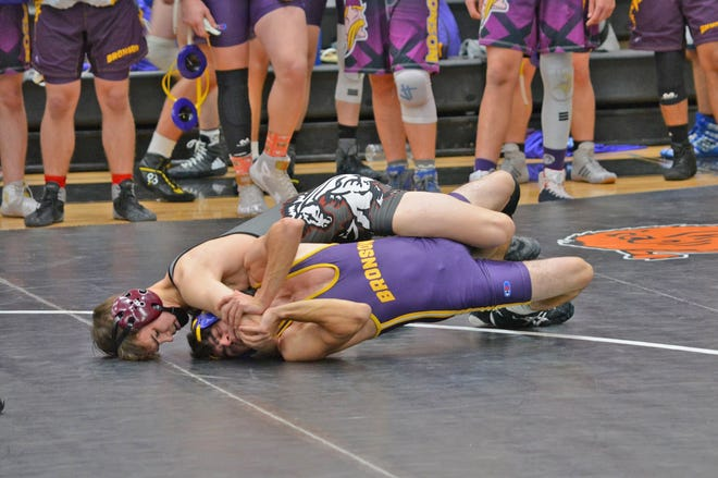 Union City's Brayton Mears turns Bronson's Blake Platter for a pin fall Wednesday night. Bronson went on to win the dual.