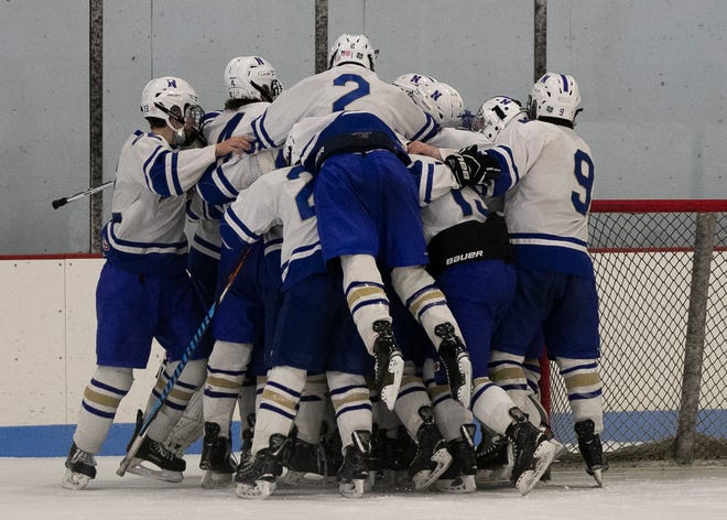 Norwell varsity boys hockey celebrate after defeating Middleboro 10-1 for the South Shore League Cup Championship at the Rockland Ice Rink on Thursday, Feb. 18, 2021.