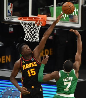 Atlanta Hawks center Clint Capela (15) blocks the shot of Boston Celtics guard Jaylen Brown during the second half of Wednesday night's game at TD Garden in Boston.