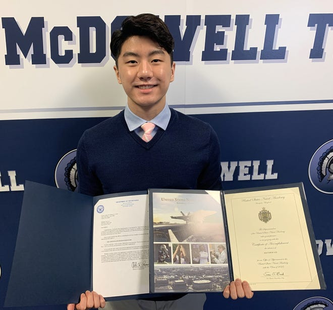 Matthew Lee, 17, of Millcreek, shows acceptance letters from the U.S. Air Force Academy, left, and U.S. Naval Academy.