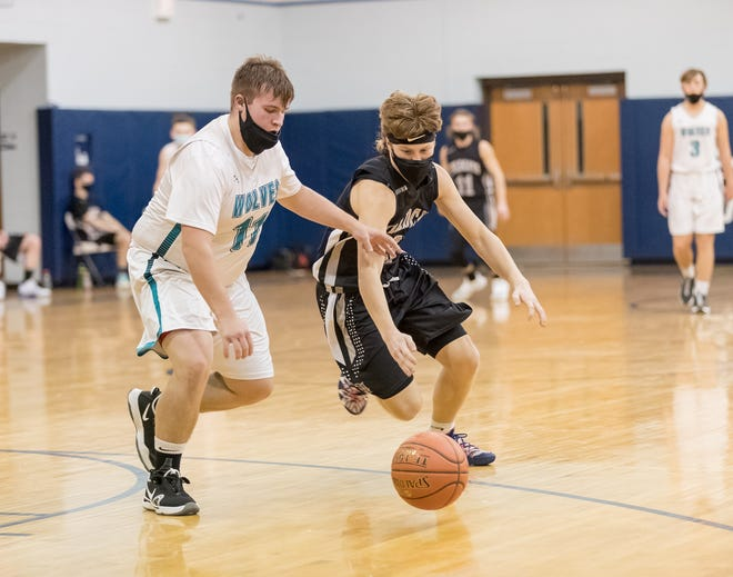 Arkport/Canaseraga's Noah Sleight, left, and Jasper-Troupsburg's Noah Price chase down a loose ball Wednesday night.