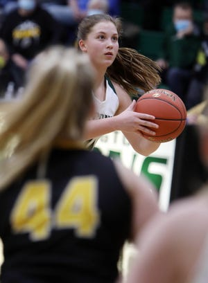 West Burlington High School's Abbey Bence (20) prepares to shoot the ball during their Class 3A regional semifinal game against Central Lee High School, Wednesday Feb. 17, 2021 at West Burlington.