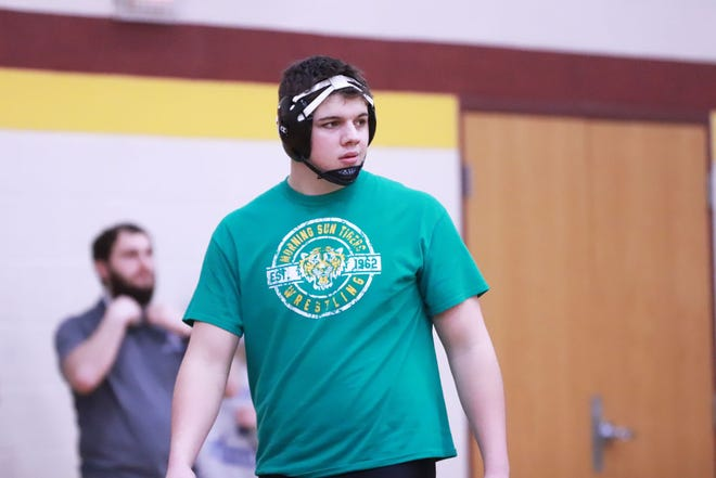 Columbus/Winfield-Mount Union high school senior heavyweight Chance Malone sports a Morning Sun wrestling shirt during a Class 2A district tournament Feb. 13 at Mount Pleasant. M<alone is keeping the Morning Sun and Malone family tradition going at the state tournament this week in Des Moines.