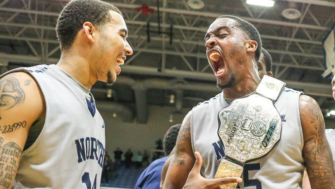 UNF's Dallas Moore (left) and Chris Davenport celebrate the Ospreys' ASUN title in 2015, the last time the conference tournament championship game was at UNF Arena.
