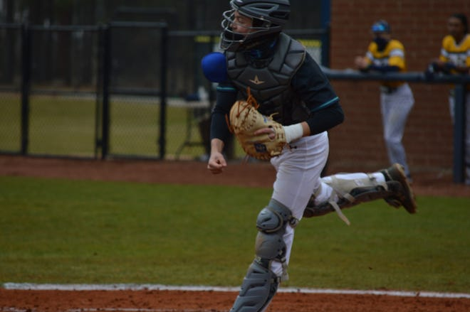 Cleveland Community College catcher and Burns product Zachary Wilson throws down to second during his team's game at Florence-Darlington Tech.