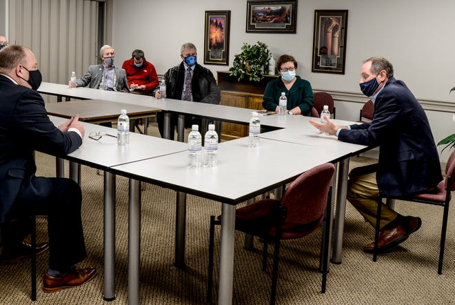 U.S. Rep. Tracy Mann, right, meets with local leaders Wednesday at the Garden City Area Chamber of Commerce office.