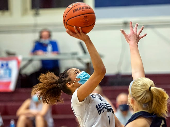 "Monmouth-Rosevlle's Kelci Shelton glides through the lane for a layup over a Knoxville defender during the Titans' 50-44 win over the Blue Bullets at ""The Shoebox"" on Wednesday night."