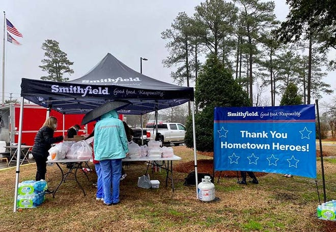 """Smithfield Foods recently hosted a socially distanced appreciation luncheon for """"Thankful Thursday"""" for Onslow Memorial Hospital employees for their ongoing service to keep the Jacksonville community safe. Smithfield Foods came out despite the rainy weather to provide meals for hospital employees."""