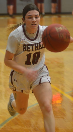 Bethel junior Macie Price runs down a loose ball during play Wednesday in North Newton. Price scored 20 points in a 65-56 Bethel win over Bethany.