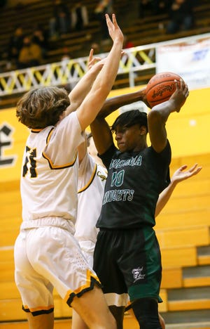Nordonia center Damon Wallace pulls down a rebound during the Knights' 47-33 win at Cuyahoga Falls Wednesday.