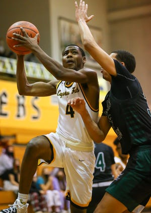 Cuyahoga Falls' Isaiah Campbell drives to the basket during the Black Tigers' 47-33 home loss to Nordonia Wednesday.