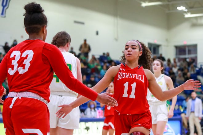 Brownfield's Deja Johnson (33) and Dabria Blackwell (11) high-five during a Class 3A area game Feb. 17 against Idalou at LCU's Rip Griffin Center.