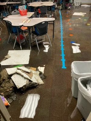 A classroom is flooded at Alderson Elementary in Lubbock.