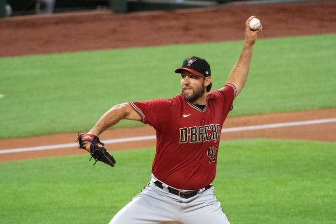 Arizona Diamondbacks Madison Bumgarner throws against the Texas Rangers during the first inning of a baseball game in Arlington, Texas, in this Wednesday, July 29, 2020, file photo.