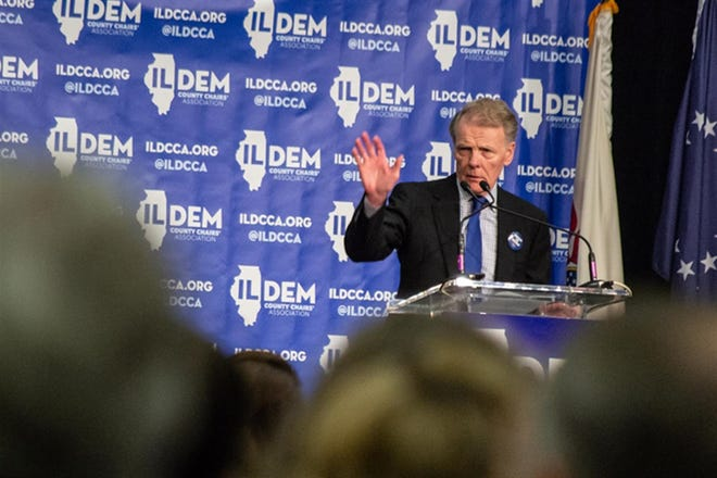 Former House Speaker Michael Madigan speaks at an Illinois Democratic County Chairs Association brunch in 2019. He announced Thursday that he will step down as a member of the House of Representatives at the end of the month.