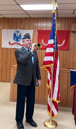 Jim Chaney plays Taps leading up to a moment of silence for the sacrifice of the Four Chaplains to close the recent American Legion observance.