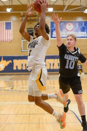 Markei Hampton drives to score two of his 12 points as Potomac State downed Garrett College on Wednesday night at the Lough Gym.
