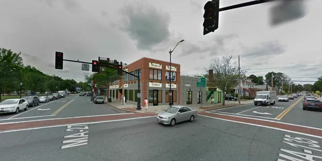 An architectural rendering of a proposed two-story building at the corner of South Main and West Central Streets in Natick.