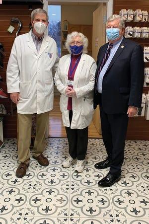Jim Munsey, Elaine Bunick and Lt. Gov. Randy McNally at Munsey Pharmacy.