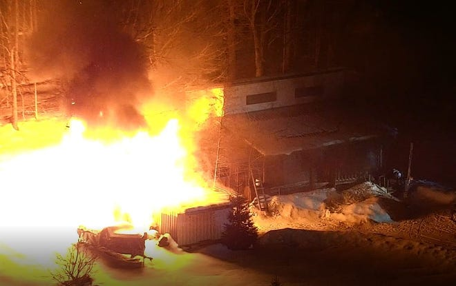 The fire at the scene of the Madison County standoff.
