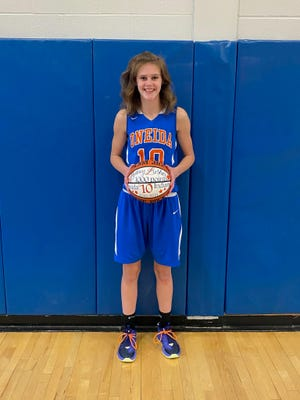 Sydney Lusher commemorates reaching 1,000 points with Oneida High School on Thursday.