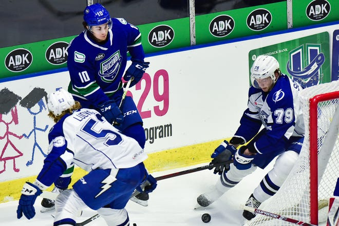 """Utica Comets forward Will Lockwood (10) tries to make a pass during the team's recent game against the Syracuse Crunch. Lockwood is in his first pro season after playing at the University of Michigan. Comets coach Trent Cull said Lockwood has """"moxie."""""""