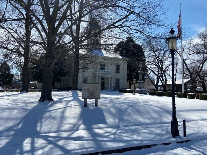 The Crawford County Court House seen Thursday, Feb. 18, 2021, is framed by untouched now. Van Buren received up to 5 inches, leaving many facilities closed and street departments working to clear the roads.