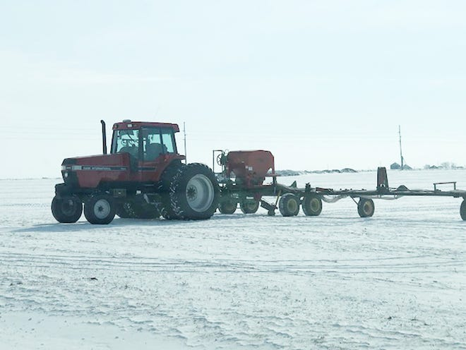 A tractor and applicator stands in a field just south of Fairbury recently.