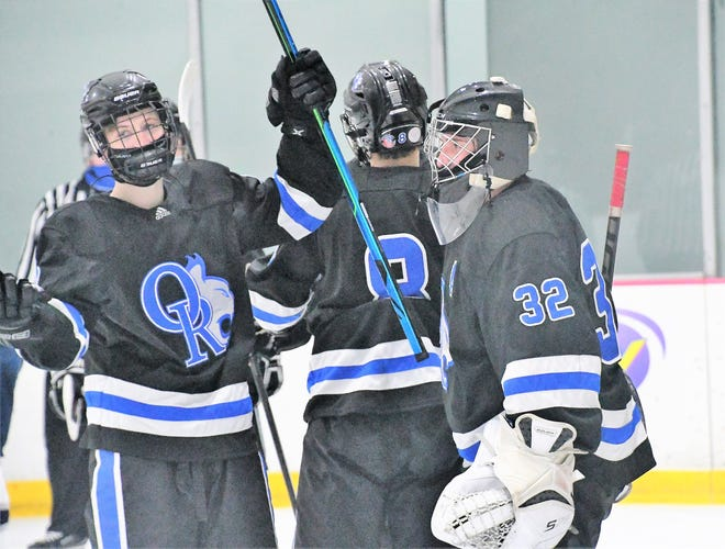 Oyster River teammates congratulate goalie Claden Daubney, right, after Wednesday's 3-1 Division II win over St. Thomas Aquinas in Dover.