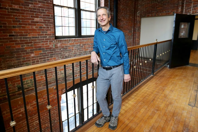 Warren Daniel, the New Hampshire Small Business Development Center regional director, seen in the Washington Street Mills in Dover Thursday, Feb. 18, 2021, could lose all funding to help local businesses if cuts included in Gov. Chris Sununu's budget go through.