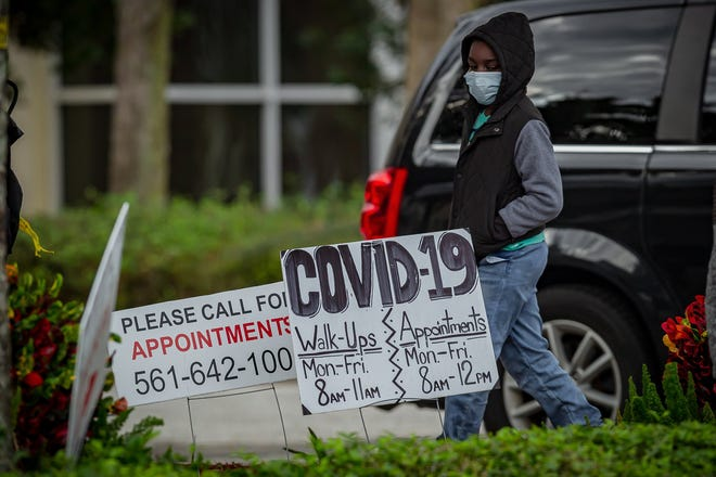 People are tested for COVID-19 at Lakeside Medical Center in Belle Glade, Fla., on Friday, December 11, 2020. The Health Care District of Palm Beach County walk-up testing site is open 8 a.m. to noon and operates Monday through Friday.