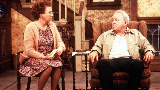 Jean Stapleton (l.) and Carroll O'Connor as Edith and Archie Bunker on the long-running sitcom, All in the Family.