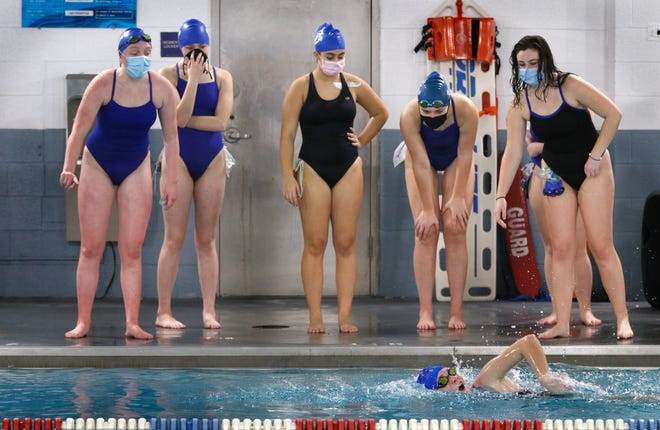 Cumberland High School swimmers cheer on their teammate at Tuesday's virtual meet. The Clippers were competing against Bay View, who swam days earlier.