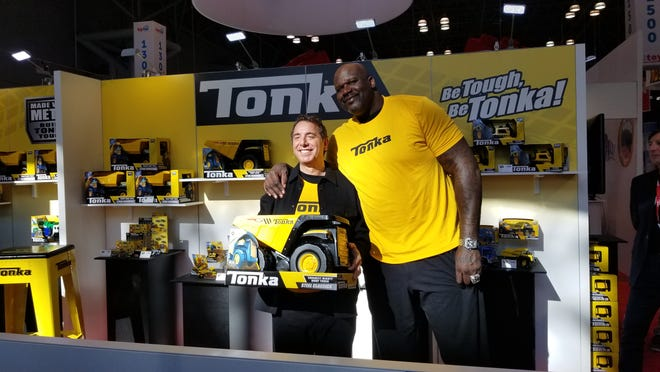 Basketball star Shaquille O'Neal, right, poses for photos at Toy Fair 2020 at New York City's Javits Center, which one month later would house a COVID-19 field hospital.