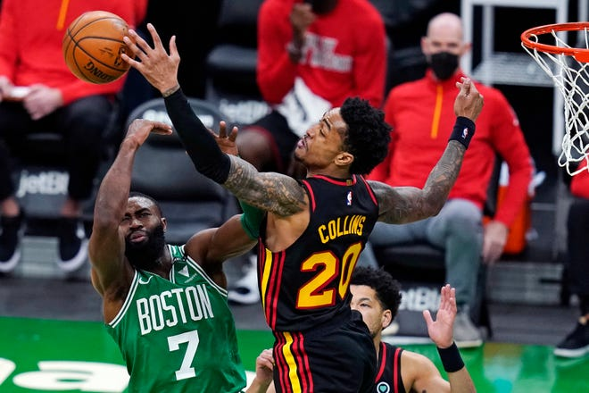 Hawks forward John Collins blocks a shot by Boston's Jaylen Brown during the second half of Wednesday's game at TD Garden.