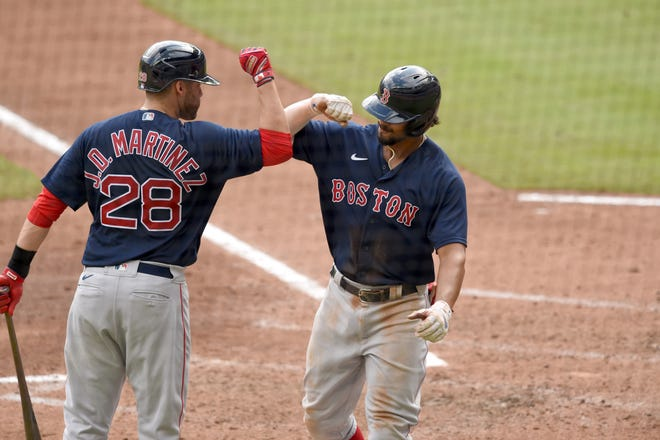 J.D. Martinez, left, and Xander Bogaerts celebrate a home run last September. They are among the few players left from Boston's 2018 title-winning team.